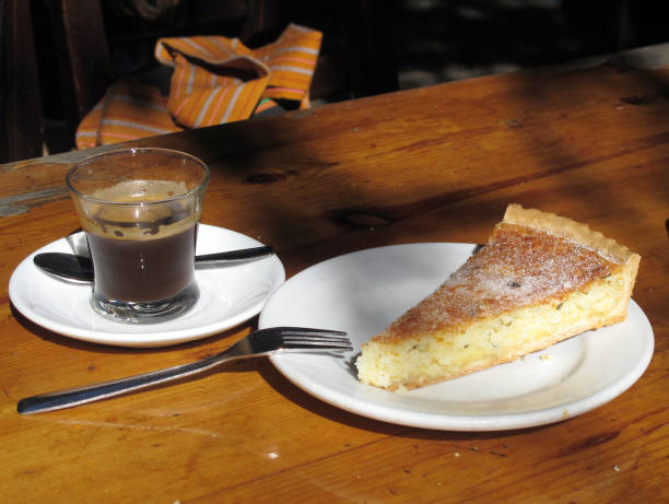 Piece of Flao, a type of cheese cake with a slight taste of mint and anis, lies on a table at the bar Anita in Santa Eulalia del Rio on the island...