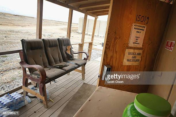 A piece of furniture sits on the porch of an abandoned office building which is in an area on Forward Operating Base Shank that is no longer used due...