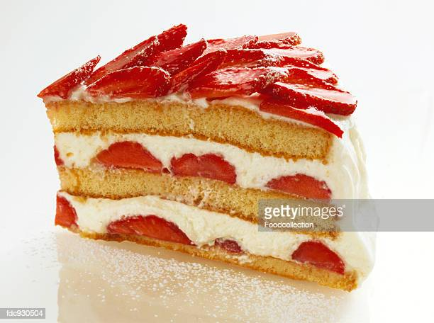 A piece of gateau with strawberries