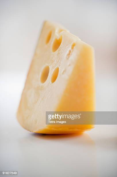 A piece of gruyere cheese
