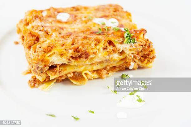 piece of lasagna on white background - lasanha imagens e fotografias de stock