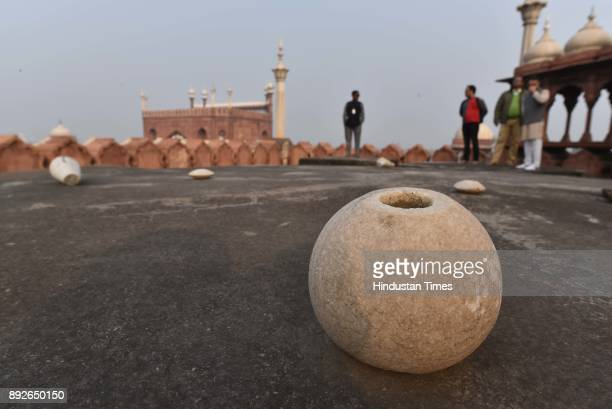 A piece of marble broken from the Jama Masjid dome is seen lying on December 13 2017 in New Delhi India The 17th century mosque built by Mughal...
