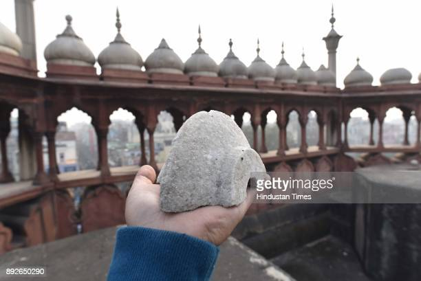 A piece of marble broken from the Jama Masjid dome on December 13 2017 in New Delhi India The 17th century mosque built by Mughal emperor Shahjahan...