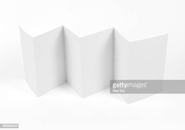 piece of paper folded to a consertina