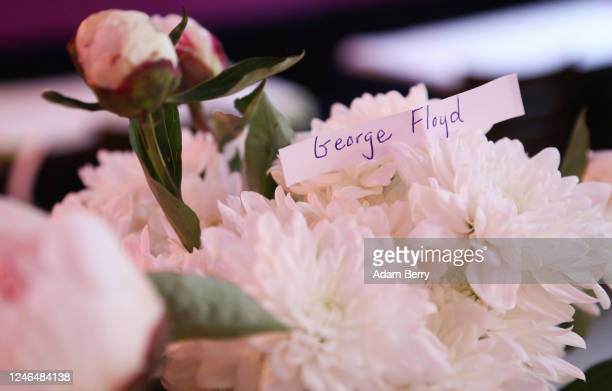 A piece of paper reads the name George Floyd amidst those of others who lost their lives to police brutality at the restaurant Rosa Caleta on June 5...