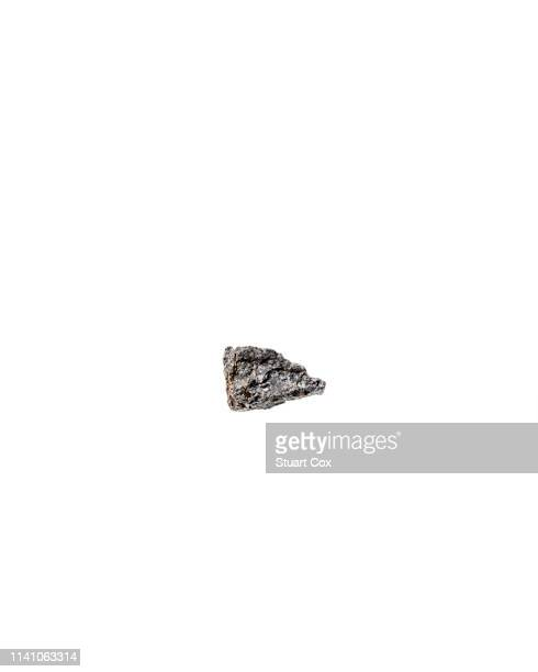 piece of raw lodestone - iron ore stock photos and pictures