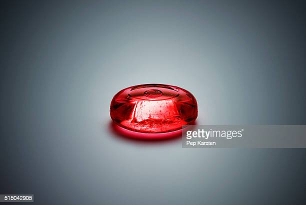 A piece of red hard candy