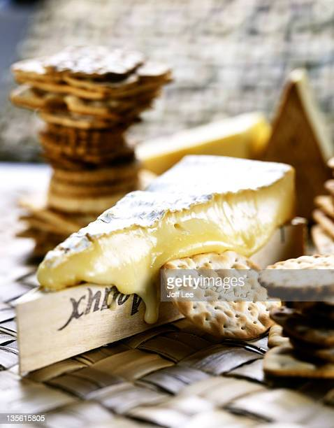 Piece of ripe & runny brie with water biscuits