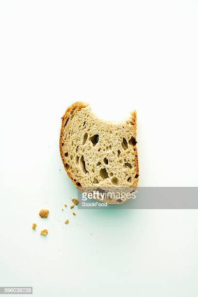 A piece of rye bread with a bite taken out