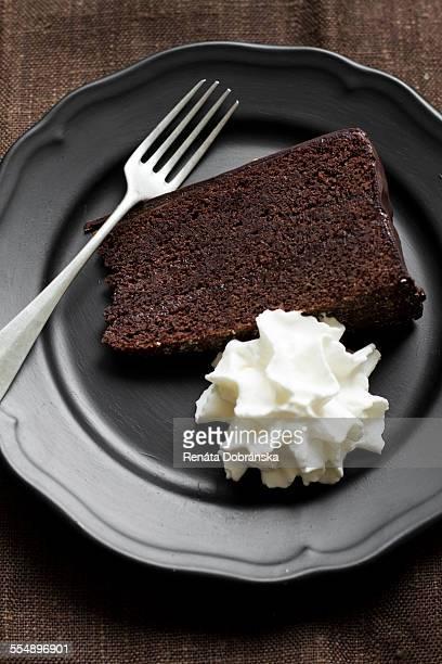 Piece of Sacher torte with cream