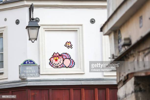 A piece of street art showing a Cat Cheshire Cat of Disney's Alice in Wonderland is seen in Rue Vieille du Temple in the 4th quarter of Paris on...
