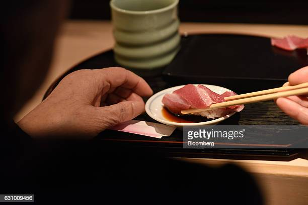 A piece of sushi prepared from a tuna that was bought at the year's first auction at Tsukiji Market in Tokyo Japan on Thursday Jan 5 2017 Kiyomura KK...