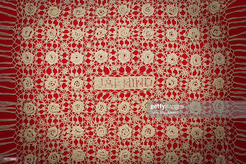 A piece of textile woven from yarn spun by Mahatma Gandhi bearing a motif 'Jal Hind' (Long Live India) is displayed at the 'Royal Wedding: 20 Novermber 1957 exhibition' at Buckingham Palace on July 27, 2007 in London. Queen Elizabeth II will be the first reigning sovereign to celebrate a 60th wedding anniversary. This new exhibition will mark the occasion by recreating the day in 1947 when Princess Elizabeth married The Duke of Edinburgh at Westminster Abbey. The collection of archive film footage, behind the scenes preparations, dresses, jewels and gifts reflect the mood of public rejoicing that swept the nation in the immediate aftermath of World War II.