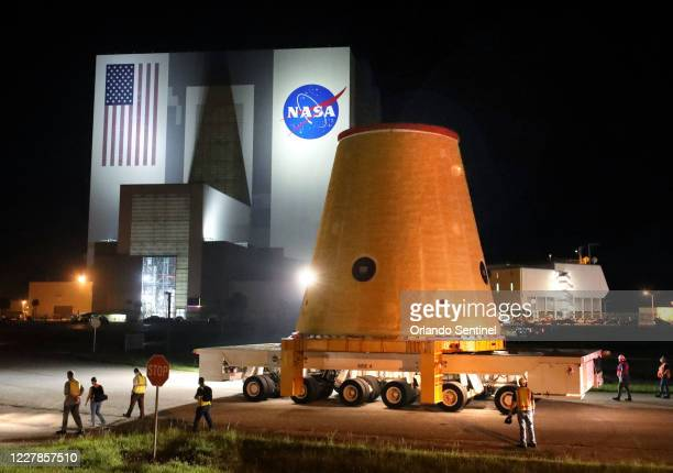 Piece of the Artemis 1 rocket is transported at Kennedy Space Center, Fla., before sunrise Thursday, July 30 after making a 13-day journey on a barge...