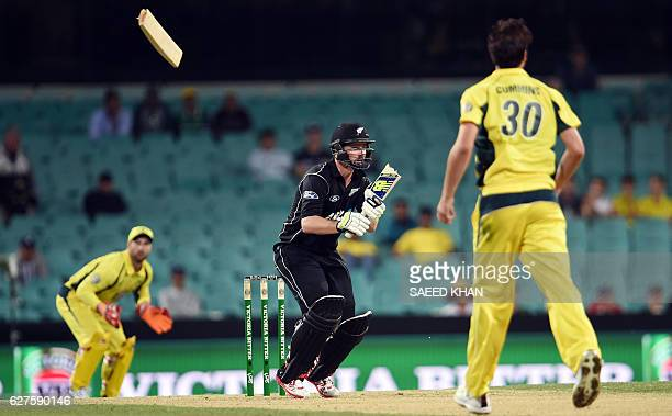 TOPSHOT A piece of the bat of New Zealand's batsman Colin Munro flies in air during the first game of the One Day International Cricket series...