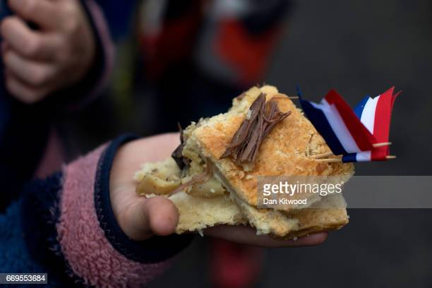A piece of the hare pie is thrown to the crowd after being carried through the village on April 17 2017 in Hallaton England Hallaton hosts the Hare...