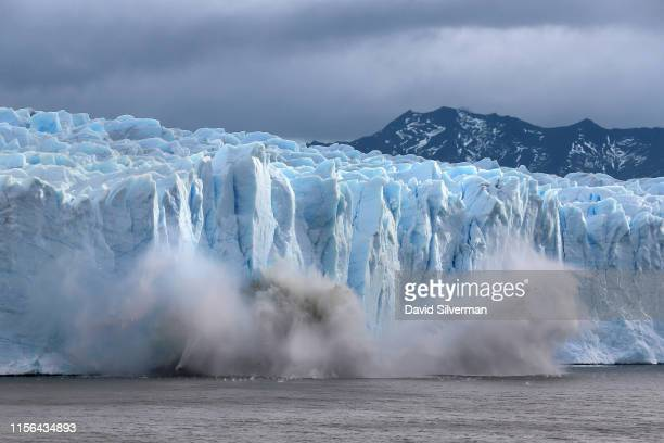 Piece of the Perito Moreno glacier, part of the Southern Patagonian Ice Field, breaks off and crashes into lake Argentina in the Los Glaciares...