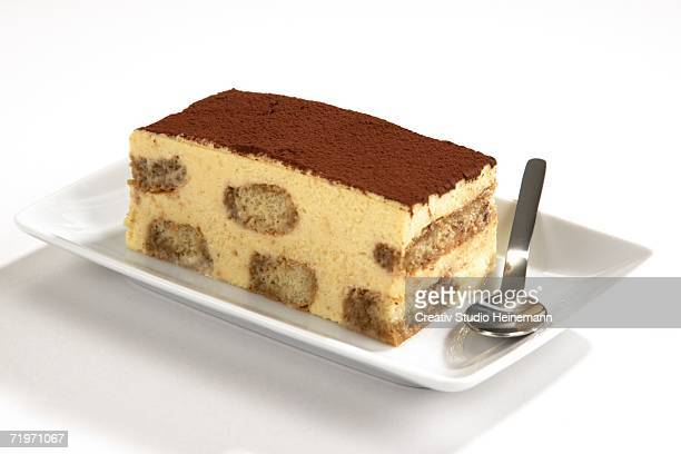 Piece of tiramisu on plate, close-up