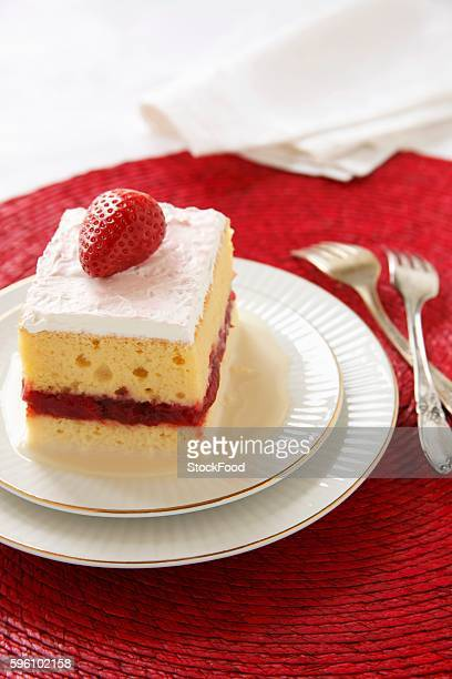 Piece of Tres Leches Cake with a Strawberry Layer; Two Forks