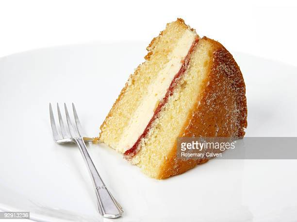 Piece of victoria sponge cake with silver fork.