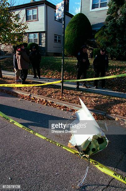 A piece of wreckage lies in the street where American Airlines Flight 587 crashed in the Rockaways Queens near JFK airport The jetliner was en route...