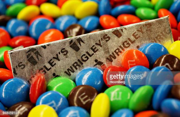 A piece of Wrigley's chewing gum and MM's candy are arranged for a photo in New York US on Monday April 28 2008 Mars Inc agreed to purchase Wm...