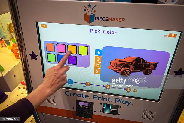 A Piecemaker Technologies 3d printer kiosk prints a Ford F150 pickup truck model at the 113th North American International Toy Fair in the Jacob...