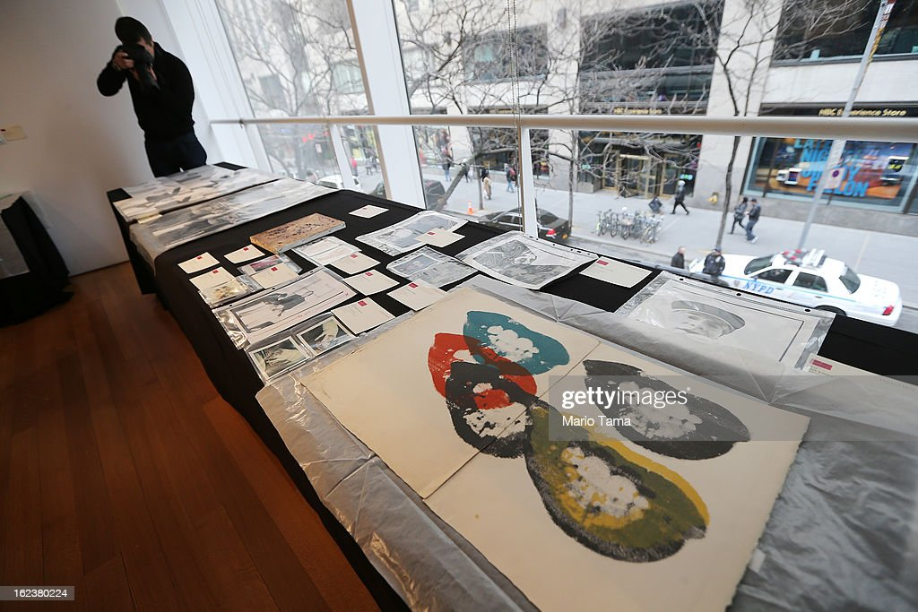 Pieces by Andy Warhol are displayed at a press preview for the Andy Warhol @ Christie's online-only sale on February 22, 2013 in New York City. The sale will be the first ever online-only sale of Warhol's work with 125 pieces and runs February 26 to March 5.