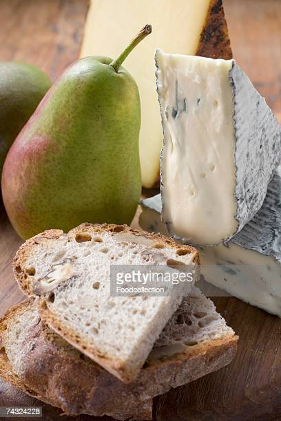 Pieces of Appenzeller and blue cheese, pears, bread