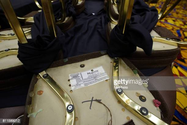 Pieces of chewing gum stick under chairs stacked on a poker table as the items are up for sale as members of the public browse the inventory of the...