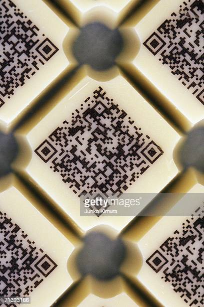 Pieces of chocolate are decorated with a URL written in twodimensional code on June 29 2006 in Tokyo Japan The chocolate is codeveloped by Mary...