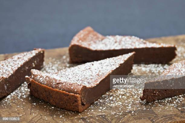 Pieces of chocolate cake on cutting board