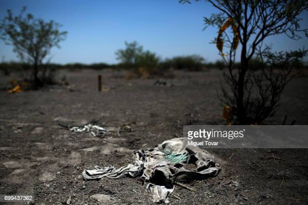 Pieces of clothing are seen near the site where human remains were found by relatives of disappeared and organizations look for clandestine graves on...