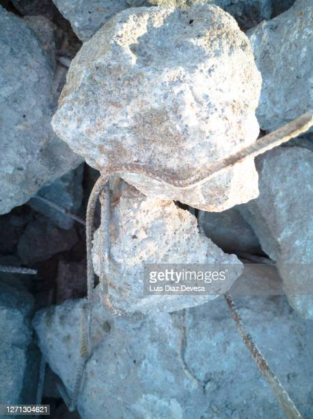 pieces of concrete and iron from the demolished of a retaining wall - rubble stock pictures, royalty-free photos & images