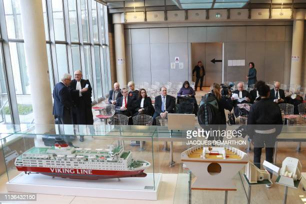 Pieces of evidence displayed in the courtroom are pictured at the Nanterre courthouse on April 12 prior to the start of the trial over 1994 sinking...