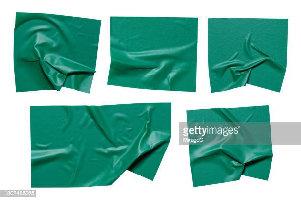 pieces of green colored plastic adhesive tape - sticker stock pictures, royalty-free photos & images