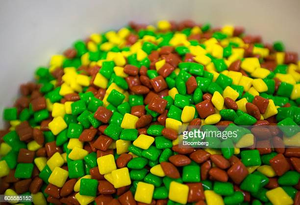 Pieces of Juicy Fruit Minis chewing gum sit in a pile on the production line ready for packing inside the Wrigley's plant operated by Mars Inc in St...