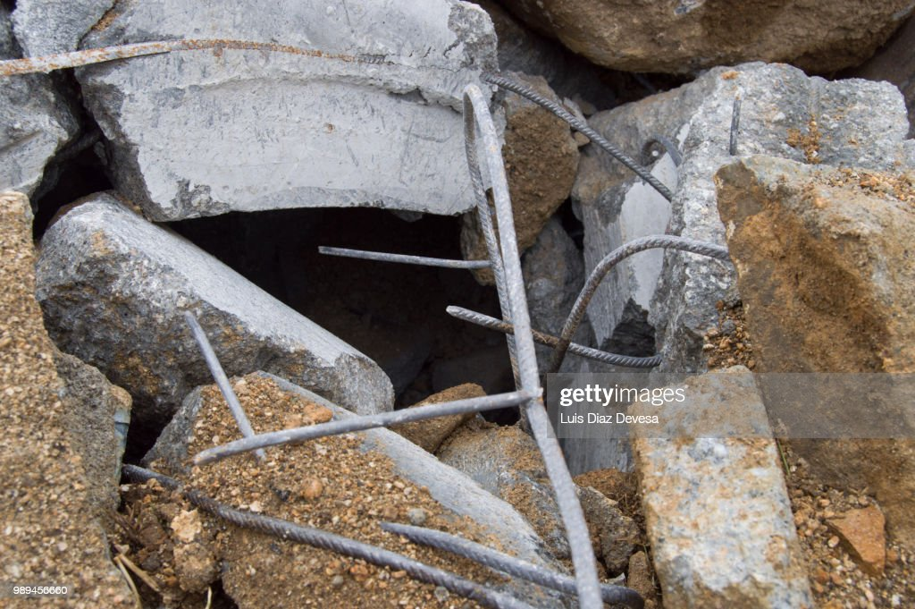 Pieces of metal and concrete by demolished : Stock Photo