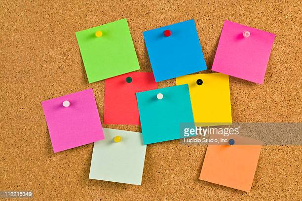 Pieces of note paper on a cork bulletin board