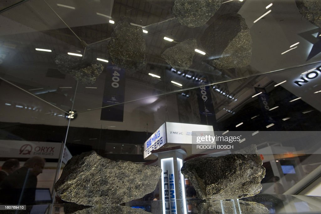 Pieces of palladium ore lie in a display case at the 19th Annual Investing in African Indaba on February 5, 2013 at the Cape Town International Convention Centre in Cape Town The Mining Indaba which is Africa's largest mining conference, attracts more than 7000 delegates from more than 100 countries, and is on focused on chaneling investment into African mining.