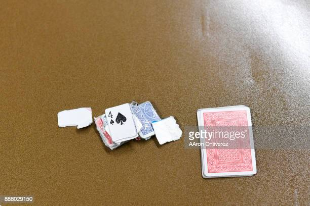 Pieces of paper and torn up cards lie on the table as chips next to a deck of cards at the Pueblo County Detention Center on Wednesday December 6...