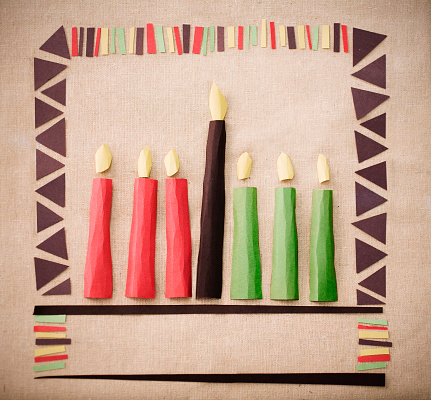 Pieces of paper cut out and placed on paper to make candles 182348076
