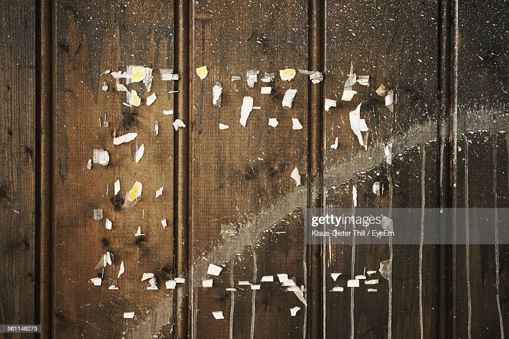 Pieces Of Paper Flying Against Wooden Wall Stock Photo