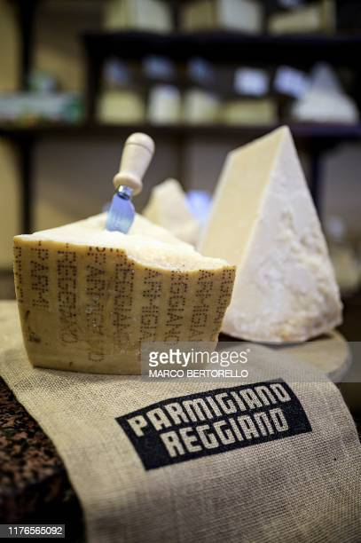Pieces of Parmigiano Reggiano Parmesan cheese are pictured on October 18 2019 at a cheese and wine shop in Saluzzo near Turin With Washington...