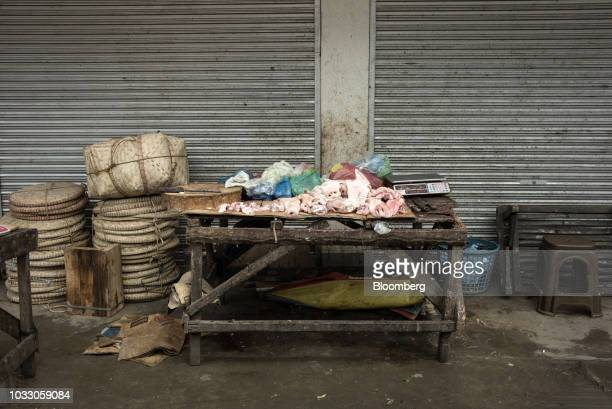 Pieces of pork sit on a table at a market ahead of Typhoon Mangkhut's arrival in Tuguegarao Cagayan province the Philippines on Friday Sept 14 2018...