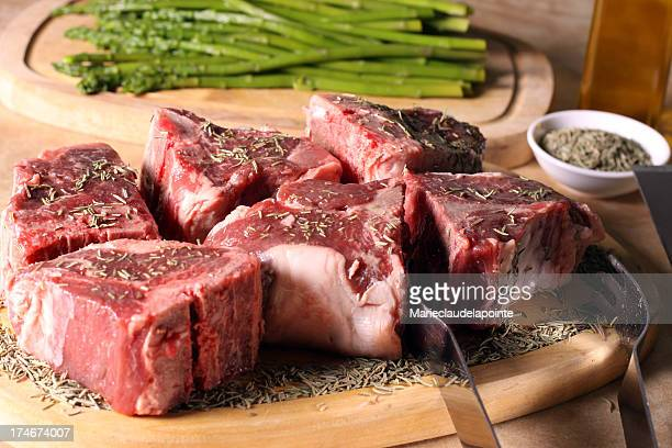 Pieces of raw meat on a wooden board