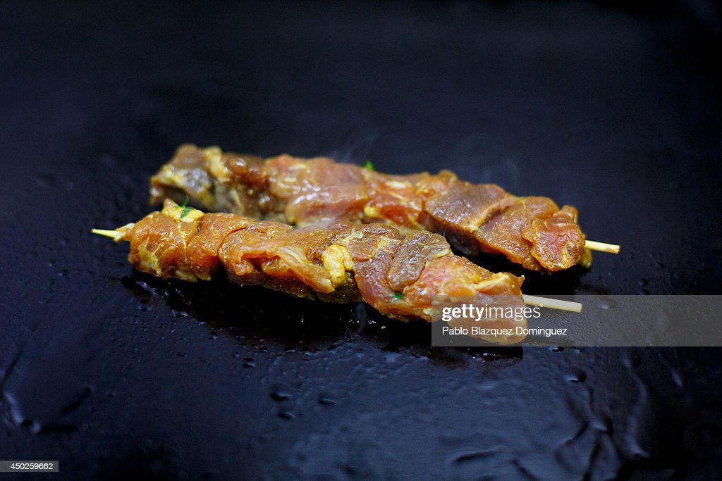 Pieces of red tuna are cooked on a griddle inside El Campero Restaurant during the end of the Almadraba tuna fishing season on June 3, 2014 in Barbate, Cadiz province, Spain. Almadraba is a traditional bluefin tuna fishing method in Southern Spain already used during Phoenician and Romans times. Fishers place mazes of nets to catch tuna migrating from the Atlantic Ocean to the Mediterranean Sea and select those that have the best size. Almadraba tuna is well demanded by Japanese for its quality. Today fishers use a different technique to control the catch amount by releasing many of the bluefin tunas before hauling the nets to avoid exceeding their limited quota fixed by International Commission for the Conservation of Atlantic Tunas 'ICCACT'. Almadraba fishers association claim the fishing quota could now be increased as fishers are struggling and the tuna population has recovered quite well.