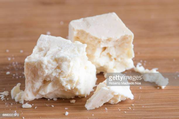 Pieces of Salvadoran Hard Cheese over a cutting board in the kitchen, food ingredients