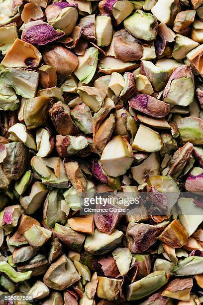 Pieces of shelled pistachios nuts with skin
