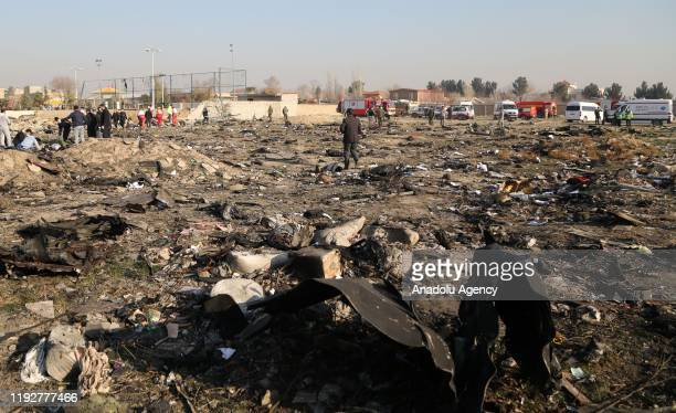 Pieces of the plane are seen at site after a Boeing 737 plane belonging to Ukrainian International Airlines crashed near Imam Khomeini Airport in...